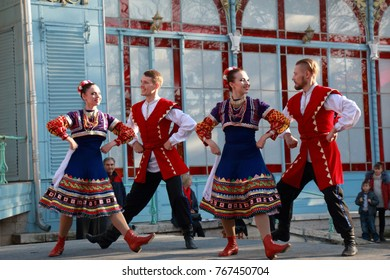 Pyatigorsk, Russia - November 4, 2017: The Cossacks in traditional clothes dance on the stage a folk dance. Free festival in honor of National Unity Day. Stage near Lermontov Gallery in Tsvetnik Park