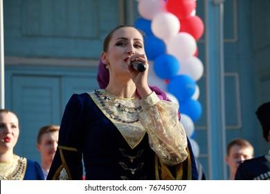 Pyatigorsk, Russia - November 4, 2017: The Cossack chorus sings the Cossack folk songs. Soloist of chorus close up. Festival in honor of National Unity Day in Tsvetnik Park