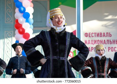 Pyatigorsk, Russia - November 4, 2017: The Cossack choir sings a folk song and dances on stage. Festival in honor of National Unity Day in Tsvetnik Park in Pyatigorsk, Stavropol Region, Russia