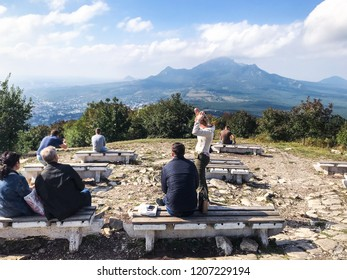 PYATIGORSK, RUSSIA - SEPTEMBER 17, 2018: tourists views five tops of Mount Beshtau from viewpoint on top Mashuk mount. Pyatigorsk is resort city in Caucasian Mineral Waters region of Stavropol Krai
