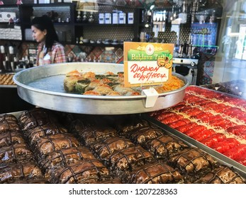 PYATIGORSK, RUSSIA - SEPTEMBER 20, 2018: seller near trays with local sweets in pastry shop in Pyatigorsk city. Pyatigorsk is resort town in Caucasian Mineral Waters region of Stavropol Krai