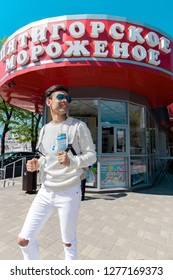 Pyatigorsk, Stavropol Territory, country Russia 01/05/2018 A young guy stands on the street near the famous cafe Mr. Sloykin Pyatigorsk Ice-cream