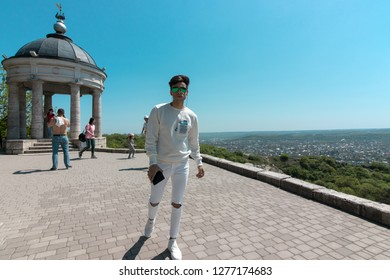 Pyatigorsk, Stavropol Territory, country Russia 01/05/2018 A Handsome guy posing in Pyatigorsk near the sights of the Eolian Harp on Mount Mashuk
