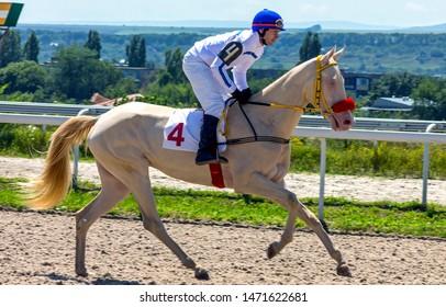 "PYATIGORSK,RUSSIA - AUGUST 04,2019: Horse race for the prize of the ""Cherkezovoi"" of Pyatigorsk hippodrome,Northern Caucasus,Russia."