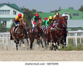 PYATIGORSK,RUSSIA - AUGUST 8:The race for the prize of the Day Railwayman;The jockey Saitgaleev,Mardanov,Aituganov,Guseinov,Gurciev and Popov. August 8; 2010 in Pyatigorsk; Caucasus; Russia.