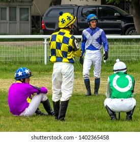 PYATIGORSK,RUSSIA- MAY 19,2019:The jockeys confer beforehorse races for the traditional prize in honor of the stallion Drug of Pyatigorsk hippodrome.