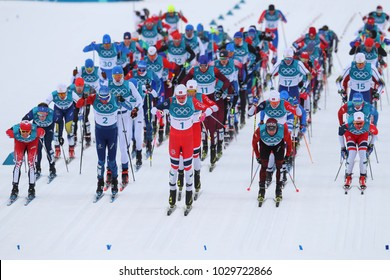 PYEONGCHANG, SOUTH KOREA - FEBRUARY 11, 2018: Mass start in the  Men's 15km + 15km Skiathlon at the 2018 Winter Olympics in Alpensia Cross Country Centre