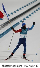 PYEONGCHANG, SOUTH KOREA  FEBRUARY 12, 2018: Olympic champion Martin Fourcade of France celebrates victory in biathlon men's 12.5km pursuit at the 2018 Winter Olympics in Alpensia Biathlon Centre