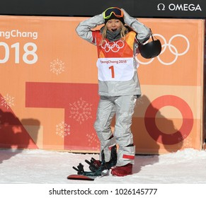 PYEONGCHANG, SOUTH KOREA – FEBRUARY 13, 2018: Olympic champion Chloe Kim celebrates victory in the women`s snowboard halfpipe final at the 2018 Winter Olympics in Phoenix Snow Park in  PyeongChang