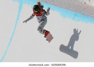 PYEONGCHANG, SOUTH KOREA - FEBRUARY 13, 2018: Olympic champion Chloe Kim of United States competes in the women`s snowboard halfpipe final at the 2018 Winter Olympics in Phoenix Snow Park