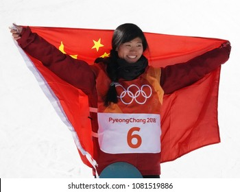 PYEONGCHANG, SOUTH KOREA - FEBRUARY 13, 2018: Silver medalist Jiayu Liu of China during venue ceremony after women`s snowboard halfpipe final at the 2018 Winter Olympics in Phoenix Snow Park