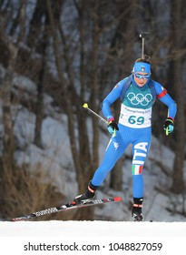 PYEONGCHANG, SOUTH KOREA - FEBRUARY 15, 2018: Dorothea Wierer of Italy competes in biathlon Women`s 15km Individual at the 2018 Winter Olympic Games in Alpensia Biathlon Centre