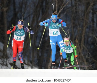 PYEONGCHANG, SOUTH KOREA - FEBRUARY 15, 2018: Dorothea Wierer of Italy (number 69) competes in biathlon Women`s 15km Individual at the 2018 Winter Olympic Games in Alpensia Biathlon Centre
