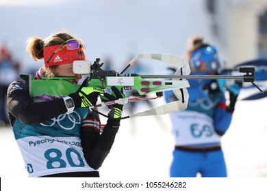 PYEONGCHANG, SOUTH KOREA - FEBRUARY 15, 2018: Olympic Champion Laura Dahlmeier of Germany competes in biathlon Women`s 15km Individual at the 2018 Winter Olympic Games in Alpensia Biathlon Centre