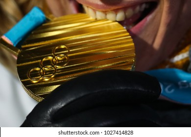Pyeongchang, South Korea - February 18, 2018: Gold medal of the Olympic games in PyeongChang 2018 in the hands of the athlete