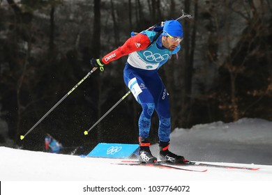 PYEONGCHANG, SOUTH KOREA  FEBRUARY 18, 2018: Olympic champion Martin Fourcade of France competes in biathlon men's 15km mass start at the 2018 Winter Olympics in Alpensia Biathlon Centre