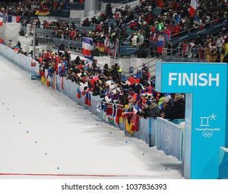 PYEONGCHANG, SOUTH KOREA - FEBRUARY 18, 2018: Biathlon fans during the biathlon men`s 15km mass start at the 2018 Winter Olympics in Alpensia Biathlon Centre