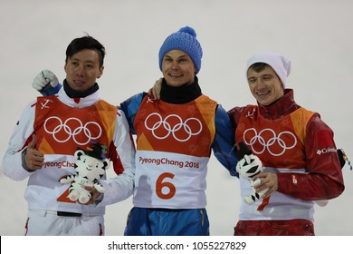 PYEONGCHANG, SOUTH KOREA FEBRUARY 18, 2018: Jia Zongyang CHN (L), Olympic champion Oleksandr Abramenko UKR and Ilia Burov OAR during venue ceremony in the Men's Aerials Freestyle Skiing