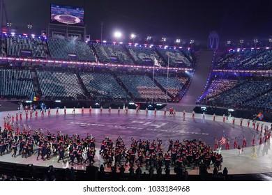 PYEONGCHANG, SOUTH KOREA – FEBRUARY 9, 2018: Olympic champion Erin Hamlin carrying the United States flag leading the Olympic team USA the PyeongChang 2018 Olympics opening ceremony