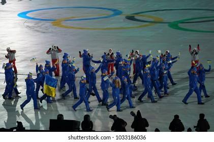 PYEONGCHANG, SOUTH KOREA – FEBRUARY 9, 2018: Olympic champion Olena Pidhrushna carrying the Ukrainian flag leading the Olympic team Ukraine the PyeongChang 2018 Olympics opening ceremony