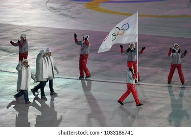 PYEONGCHANG, SOUTH KOREA – FEBRUARY 9, 2018: Volunteer carrying Olympic flag leading the Team Olympic Athlete from Russia the PyeongChang 2018 Olympics opening ceremony
