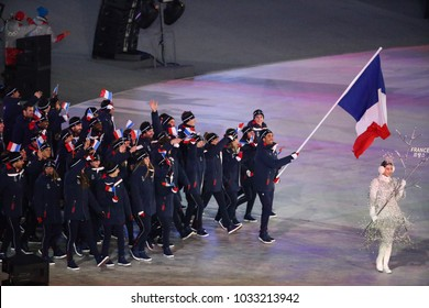PYEONGCHANG, SOUTH KOREA  FEBRUARY 9, 2018: Olympic champion Martin Fourcade carrying the French flag leading the Olympic team France during the PyeongChang 2018 Winter Olympics opening ceremony