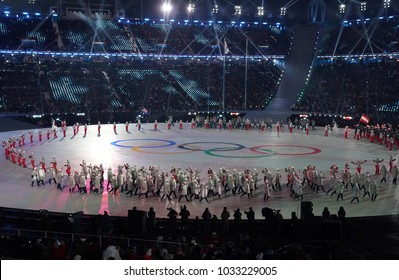PYEONGCHANG, SOUTH KOREA  FEBRUARY 9, 2018: Volunteer carrying Olympic flag leading the Team Olympic Athlete from Russia the PyeongChang 2018 Olympics opening ceremony