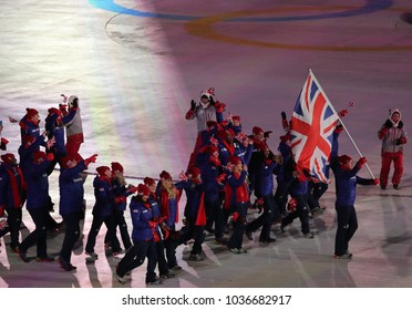 PYEONGCHANG, SOUTH KOREA - FEBRUARY 9, 2018: Olympic champion Lizzy Yarnold carrying the British flag leading the Olympic team Great Britain at the PyeongChang 2018 Winter Olympics opening ceremony