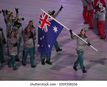 PYEONGCHANG, SOUTH KOREA - FEBRUARY 9, 2018: Snowboarder Scotty James carrying the flag of Australia leading the Australian Olympic team at the PyeongChang 2018 Winter Olympic Games opening ceremony