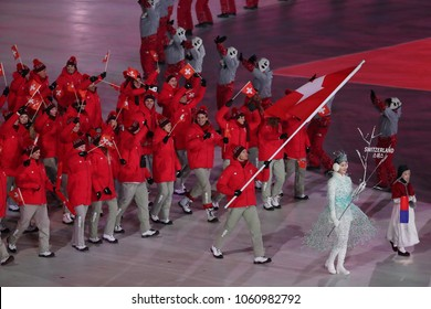 PYEONGCHANG, SOUTH KOREA - FEBRUARY 9, 2018: Olympic champion Dario Cologna carrying the flag of Switzerland leading the Swiss Olympic team at the PyeongChang 2018 Winter Olympic Games opening ceremon
