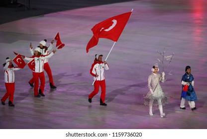 PYEONGCHANG, SOUTH KOREA - FEBRUARY 9, 2018: Ski Jumper Faith Aroa Ipioglu carrying the flag of Turkey leading the Turkish Olympic team at the PyeongChang 2018 Winter Olympics opening ceremony