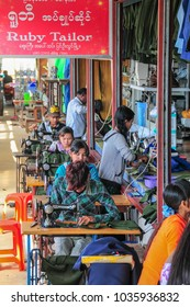 Pyin Oo Lwin, Shan State, Myanmar - November 18 2014. Dressmakers sewing clothes at tailor's shop in Pyin Oo Lwin, Myanmar.