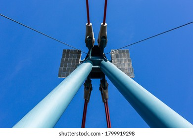 Pylon bridge. Bearing poles. steel structure. Under the blue sky.