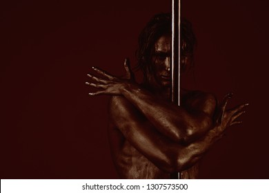 pylon dancer with silver body. pylon sport with muscular man, copy space
