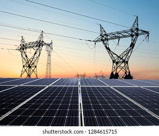 Pylon and photovoltaic panels in the evening