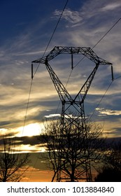 Pylon silhouetted against evening sky