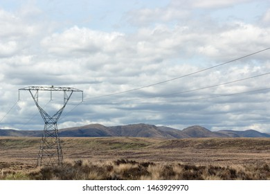 A Pylon stands tall in the Rangipo Desert, a barren desert-like environment in New Zealand, located in the Ruapehu District on the North Island Volcanic Plateau.