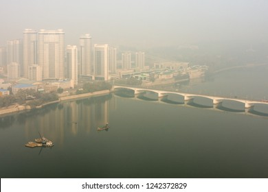 Pyongyang / DPR Korea - November 10th 2015: Pyongyang skyline with the newly built Changjon Apartment Complex and the Taedong River on a foggy day