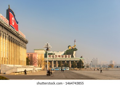 Pyongyang / DPR Korea - November 12, 2015: Kim Il-sung Square and government building decorated with national flag of Democratic People's Republic of Korea in central Pyongyang.