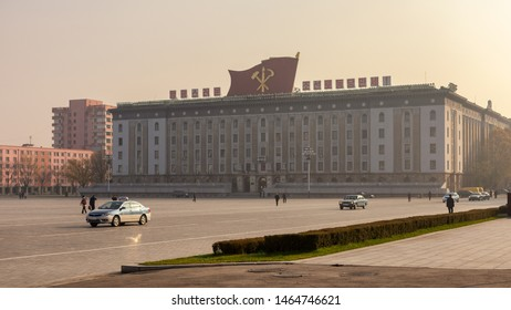 Pyongyang / DPR Korea - November 12, 2015: Kim Il-sung Square and government building decorated with flag of the Worker's Party of Korea in central Pyongyang, North Korea.