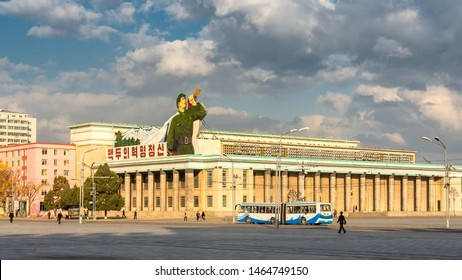 Pyongyang / DPR Korea - November 12, 2015: Kim Il-sung Square and government buildings decorated with revolutionary slogans in Pyongyang, North Korea.