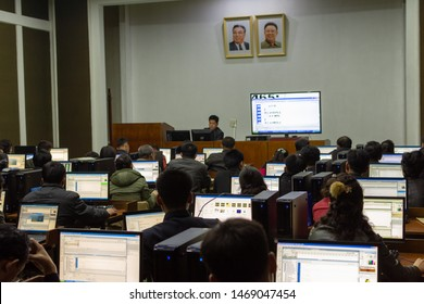 Pyongyang / DPR Korea - November 12, 2015: Students learning programming in a computer study room at the Grand People's Study House, an educational center open to all North Koreans, Pyongyang