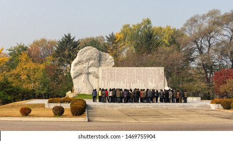 Pyongyang / DPR Korea - November 12, 2015: People pay respects in front of a communist monument in Pyongyang, North Korea