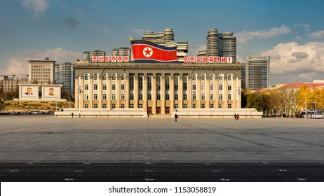 Pyongyang / DPR Korea - November 12th 2015: Kim Il-sung Square and government building decorated with national flag of Democratic People's Republic of Korea in central Pyongyang.