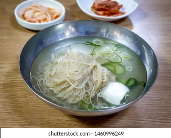 Pyongyang Naengmyeon, Korean noodle dish of long and thin handmade noodles made from buckwheat and cold broth made from beef. Chilled Buckwheat Noodle Soup, North Korean traditional food.