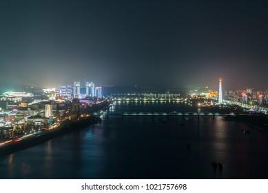 Pyongyang night skyline lights with taedong river