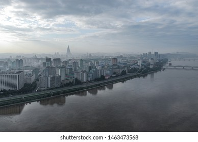 Pyongyang, North Korea, 2 August 2014. Skyline of the North Korean capital with Taedong river on a summer day seen from Yanggakdo hotel