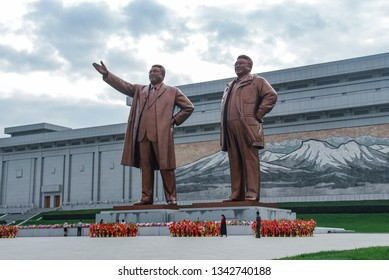 Pyongyang, North Korea - 25 July 2014. Mansu Hill Grand Monument with giant bronze statues of North Korean leaders Kim Il Sung and Kim Jong Il.