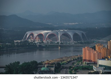 Pyongyang, North Korea - 26 July 2014. Rungrado 1st of May Stadium in DPRK capital seen with Taedong river seen from top of Juche tower
