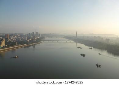 Pyongyang, North Korea - AUG 2012: The sunrise view of Pyongyang city and Taedong River